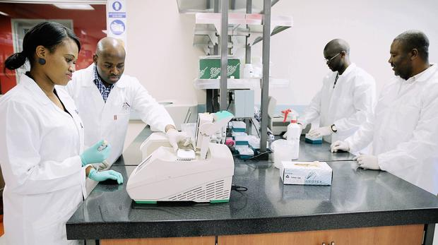 DPhD fellows Zandile Sibisi, from left, Benjamin Chimukangara, Mlungisi Dlamini and Dr Tongo Marcel work on the state-of-the-art DNA sequencing machines at the KZN Research and Innovation Sequencing Platform (KRISP) centre, based at UKZN