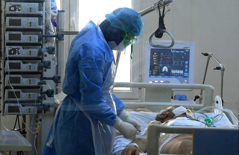 KRISP Tulio de Oliveira in the News 24 A doctor attends to a Covid-19 patient at the intensive care unit.